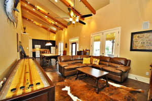 cave-is-an-airy-lounge-out-of-a-katy-tex-home-dig-your-toes-into-the-snuggly-bear-skin-rugs-as-you-watch-the-super-bowl-or-while-playing-some-games