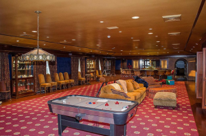 exas-heres-a-theater-like-houston-man-cave-that-offers-you-and-your-buddies-a-ton-of-plush-seating-and-the-option-of-a-nostalgic-game-of-noc-hockey