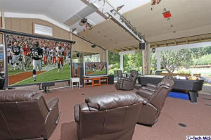 in-the-suburbs-of-glendale-choose-between-watching-the-game-on-a-large-standard-tv-or-an-even-larger-professional-quality-projection-screen