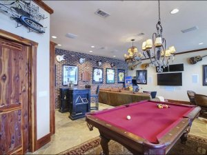 ve-in-this-graford-tex-home-features-a-relaxed-setting-where-you-can-kick-back-with-a-beer-and-admire-the-cool-guitars-on-the-wall-in-between-plays
