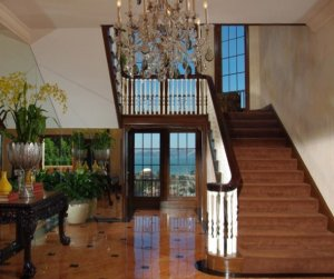great-marblework-and-a-huge-chandelier-in-the-foyer